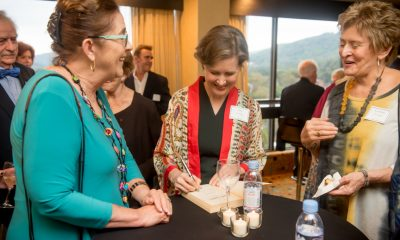 Ann Patchett personalizing books for guests
