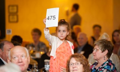 Our youngest donor in the Fund-a-Need Live Auction