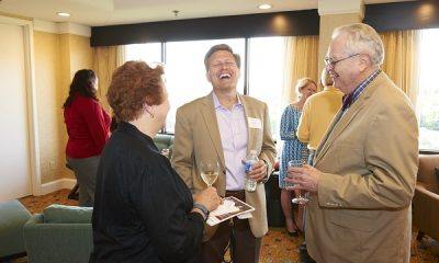 David Baldacci laughing with guests